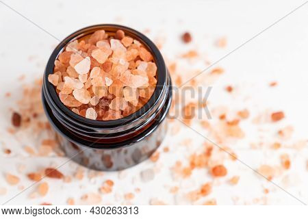 Himalayan Pink Rock Salt. Mineral-rich Salt From The Himalayan Region. In Glass Jar On Wite Backgrou