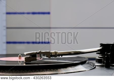 Vinyl Record And Turntable During Analog To Digital Audio Conversion Using Computer Software.
