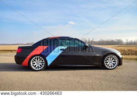 Berlin - April 2014: : Bmw 3 Series E93 328i Convertible With M-pack Logo Stripes Outdoors. Right Si