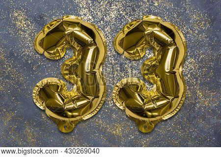 The Number Of The Balloon Made Of Golden Foil, The Number Thirty-three On A Gray Background With Seq