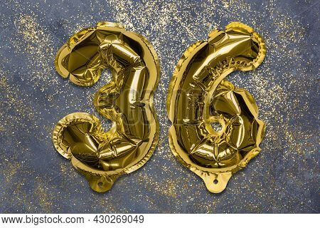 The Number Of The Balloon Made Of Golden Foil, The Number Thirty-six On A Gray Background With Sequi