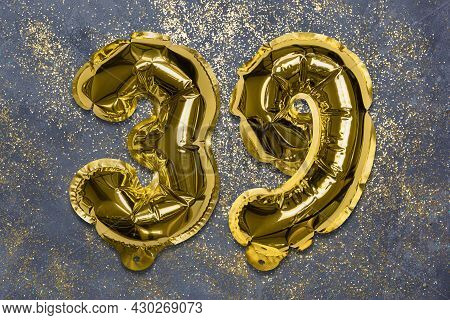 The Number Of The Balloon Made Of Golden Foil, The Number Thirty-nine On A Gray Background With Sequ