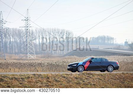 Berlin - April 2014: : Bmw 3 Series E93 328i Convertible With M-pack Logo Stripes Outdoors. Left Sid