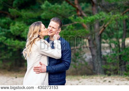 Happy Loving Couple Enjoying Kissing Moments Of Happiness In Park. Love Tenderness,dating, Romance.