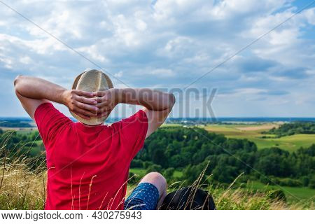 Young Man Admiring Beautiful View Of The Forest Landscape Rear View.young Man Standing Alone Summer