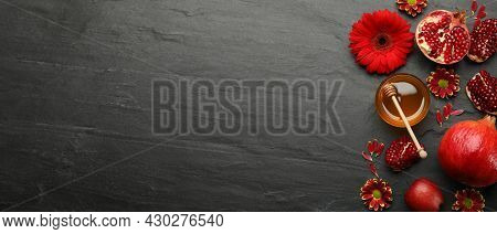 Flat Lay Composition With Rosh Hashanah Holiday Attributes On Black Background, Space For Text. Bann