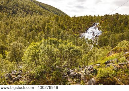 Travel, Beauty In Nature. Waterfall Torrential River Along The Aurlandsfjellet Mountains In Norway S
