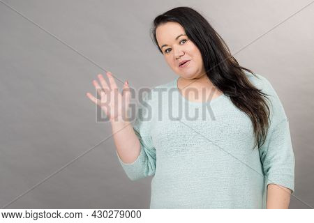 Adult Plus Size Woman Wearing Casual Clothing Bright Sweater Pullovers Having Fun Waving With Hand