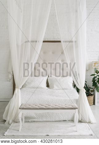 White Bedroom Interior, Closeup At Canopy Bed. Home Room For Sleep, Vintage Decoration Of House. Com