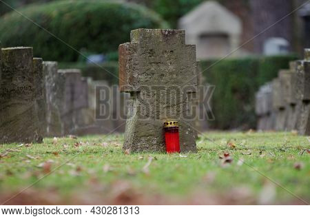 Gravestones And Grave Light At A Military Cemetery Of The Second World War In Germany
