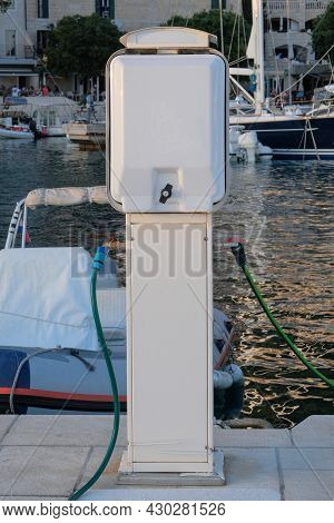 Refueling Yachts With Water On Boats Dock In Sea Coast. Concept Of Developing Convenient Boat.