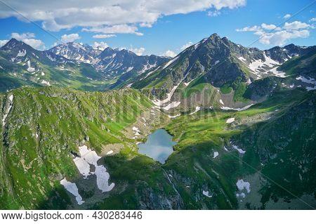 Aerial beautiful summer landscape of Caucasus mountain. Skazka of Caucasus lake near Arkhyz village in Russia. Daylight mountain landscape.