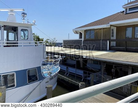 Bay Shore, New York, Usa - 5 June 2021: View From The Top Of A Ferry Of Another Boat Docked In A Sli