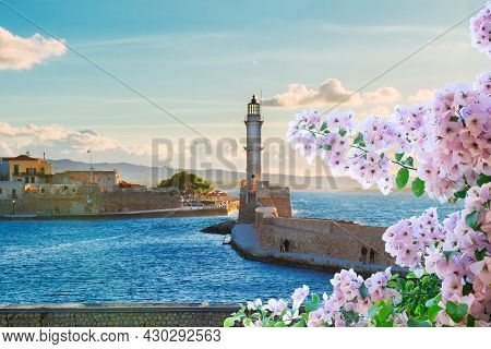Bay Of Chania With Sea And Lighthouse At Sunny Summer Sunset With Flowers, Crete, Greece