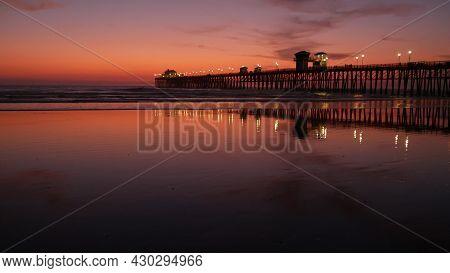 Pier Silhouette Oceanside California Usa. Pacific Ocean Tide Tropical Beach. Summertime Gloaming Atm