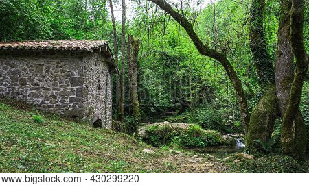 Abandoned Mill On A River In Northern Spain. Concept Of Lonely And Peaceful Place, Melancholy