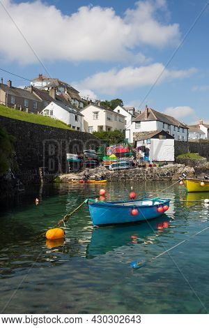 Coverack, Cornwall, Uk - July 1, 2021.  The Picturesque Harbour And Village Of Coverack In Cornwall