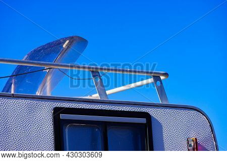 Sunroof, Raisable Panel Window On Roof Top Of Rv Caravan Against Blue Sky. Travel With Motor Home Ve