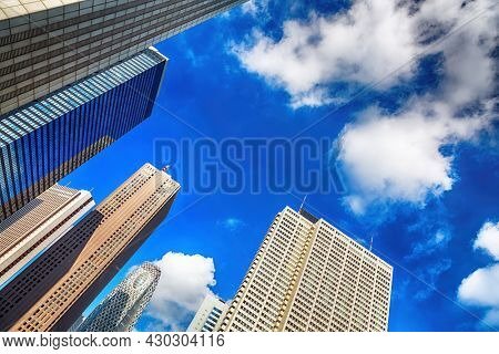 Tokyo urban cityscape, with high-rise office buildings. Blue sky and cloud background and HDR processing. Japan.