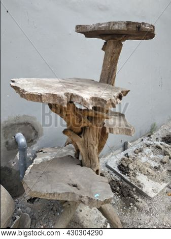 Shelves For Pots Made Of Tree Trunks And Roots