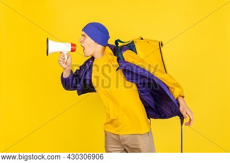 Comic Portrait Of Young Man, Delivery Guy In Uniform Isolated On Yellow Studio Background. Concept O