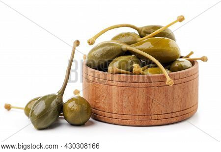 Pickled Capers In A Plate Close-up On A White Background. Isolated