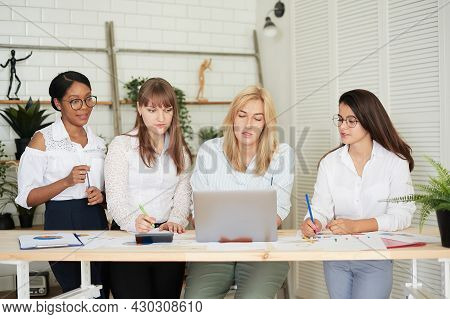 Smiling Women Work Together In A Modern Office. Feminism. Professional Smiling Business Women Standi