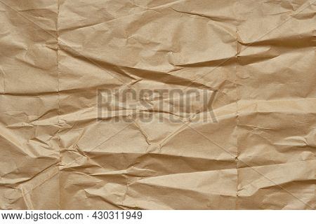 Crumpled Brown Paper Texture Background, Creased Wrapping Paper.