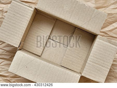 Top Down Of Brown Paper Box Opened, Inside Is Empty, Wrapping Brown Paper Background, Copy Space For