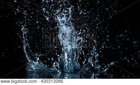 Freeze motion of water splash isolated on black background.