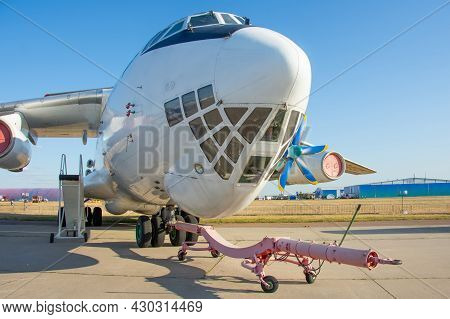 The Nose And Front Of The Cockpit Of A Military Transport Cargo Aircraft, Towing And Taxiing Carrier