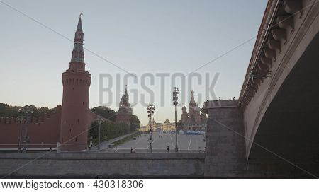 Bridge On Background Of Red Square. Action. Floating Under Bridge With View Of Kremlins Red Square.