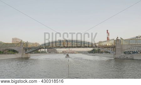 Beautiful View Of Bridge Over City Canal. Action. City Bridge Over Canal With Tourist Boats. Sailing
