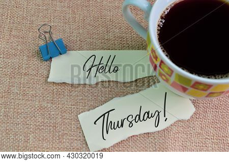 A Cup Of Coffee And Torn Papers With Text Hello Thursday