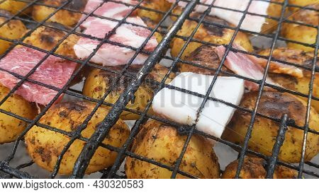 Grilled Potatoes With Bacon, Whole Baked On The Barbecue Grill. Selective Focus. Whole Small Potatoe