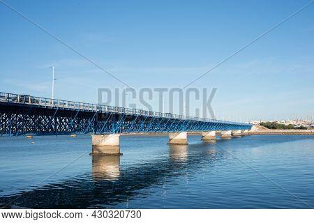 Beautiful Old Blue Bridge Over Arade River At Portimao. Cars Crossing, Portugal, Europe