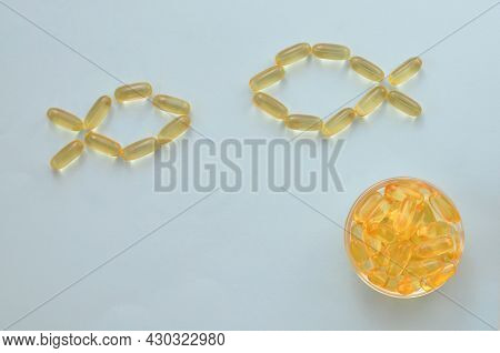 Conceptual Image Of An Omega 3 Capsule In The Form Of Two Fish