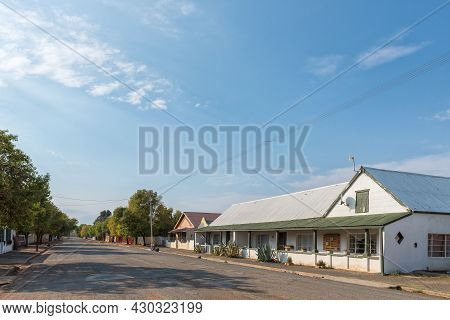 Middelburg, South Africa - April 22, 2021: A Street Scene, With Old Houses, In Middelburg In The Eas
