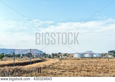 A View Of Rosmead Railway Station Near Middelburg In The Eastern Cape Province. Storage Tanks Are Vi