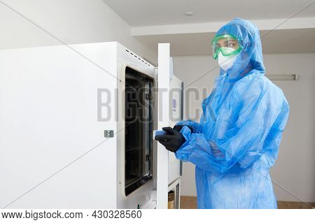 Laboratory Worker Operating Modern Laboratory Autoclave Sterilizer