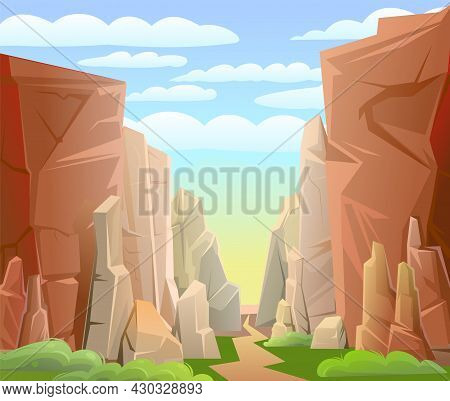 Rocky Mountain Gorge. Grass And Road. Stone Rocky Landscape. High Peaks And Cliffs. Sky With Clouds.
