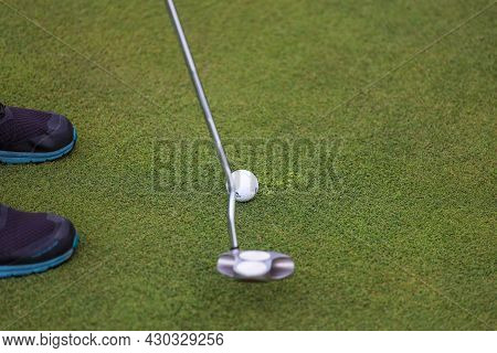 Minsk. Belarus - 25.07.2021 - Low Section Of Man Playing Golf At Driving Range On A Green Field