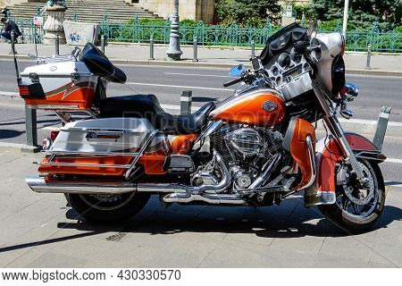 Bucharest, Romania - 6 May 2021: Harley Davidson Classic Motorcycle Parked On A Street In A Sunny Sp