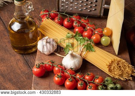 Italian Pasta (macaroni), Spaghetti Tied With Sisal String, Tomatoes, Olive Oil, Cheese And Spices O