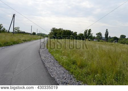 Beautiful Empty Asphalt Road In Countryside On Colored Background