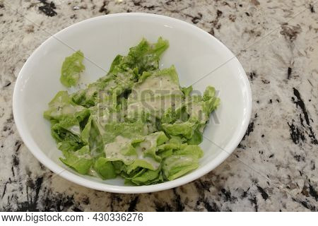 Ranch Salad Dressing On Lettuce Leaves That Were Just Harvested From An Indoor Garden. Closeup Of Fr