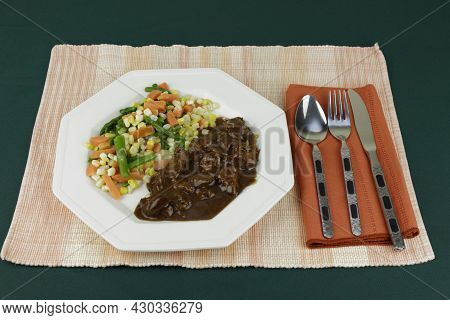 Mixed Steamed Vegetables Meal Of Green Asparagus, Orange Carrots And Yellow And White Corn With Beef