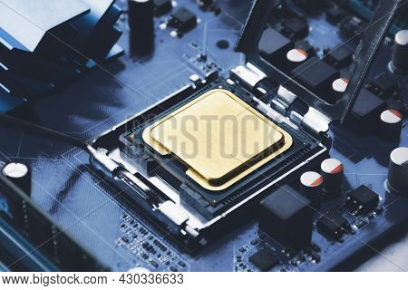 Gold Cpu Processor Chip In Connector Socket On The Computer Motherboard And Component
