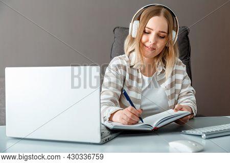 Caucasian Blonde Student Teenage Girl Watch Video Online Webinar Study Learn Via Remote E-learning.