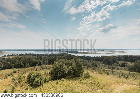 Summer Nature Landscape With Sky, Clouds, Grass, Forest Trees And Water Lakes In The Bottom. Rural S